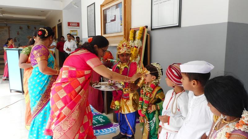 Principal mam performing pooja