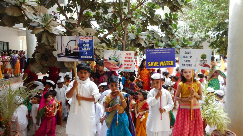 Students are giving slogan on save water save earth