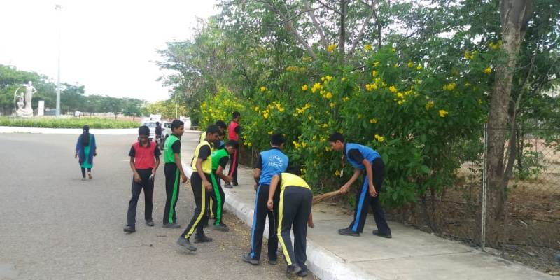 Cleaning school campus.