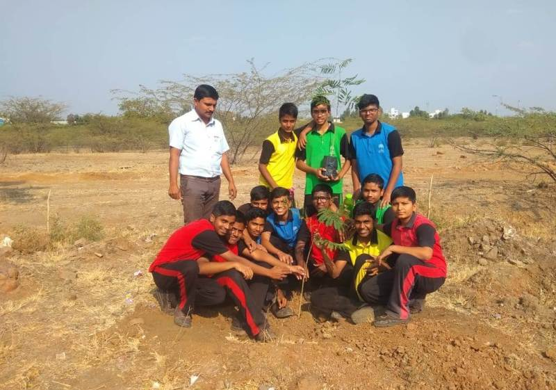 Teacher and students at tree plantation