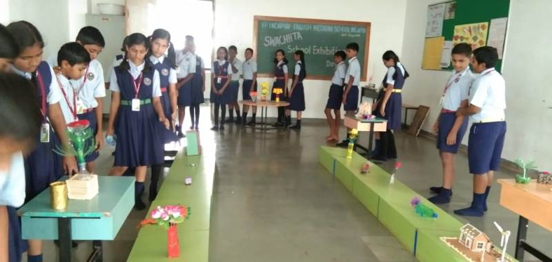 Students observing best out of waste exhibition
