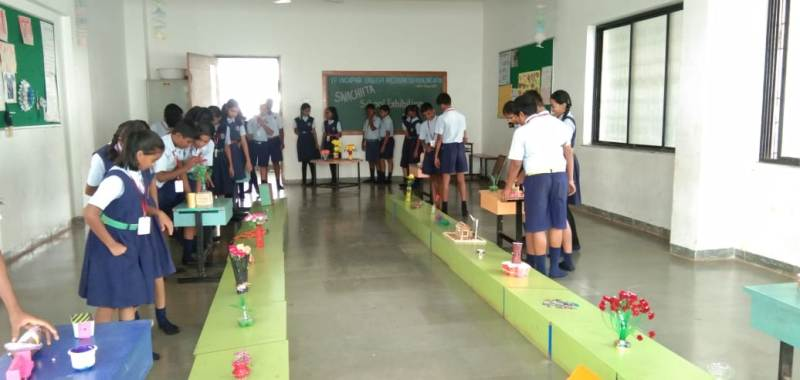 Students watching best out of waste exhibition
