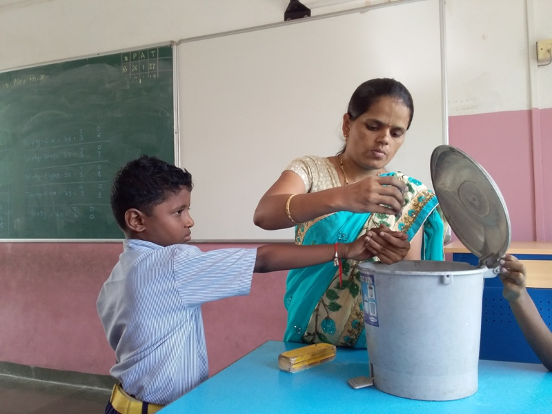 Teacher showing correct method of cutting nails