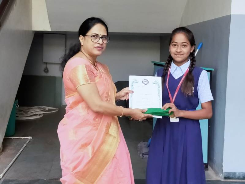 Awarded by Principal Mam with certificate & green belt in Karate Exam (2)