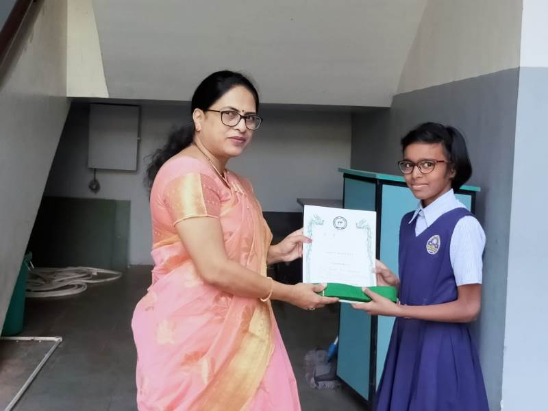 Awarded by Principal Mam with certificate & green belt in Karate Exam (3)