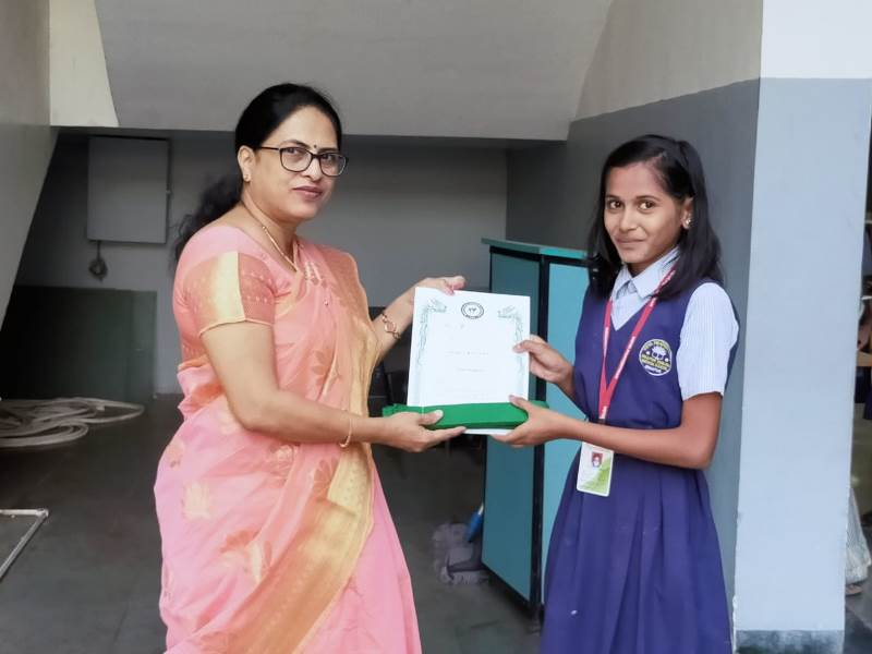 Awarded by Principal Mam with certificate & green belt in Karate Exam (4)