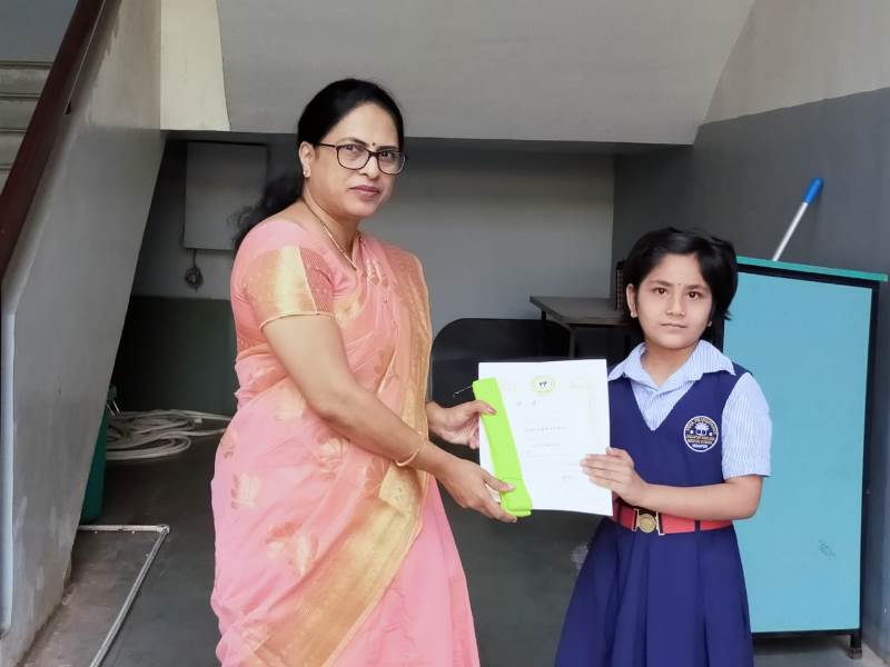 Awarded by Principal Mam with certificate & yellow belt in Karate Exam (2)