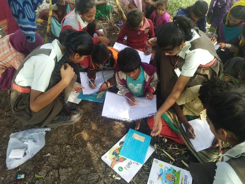 Girls Of Vpiems teaching to sugarcane worker\'s children on the occasion of Savitribai Phule Jayanti