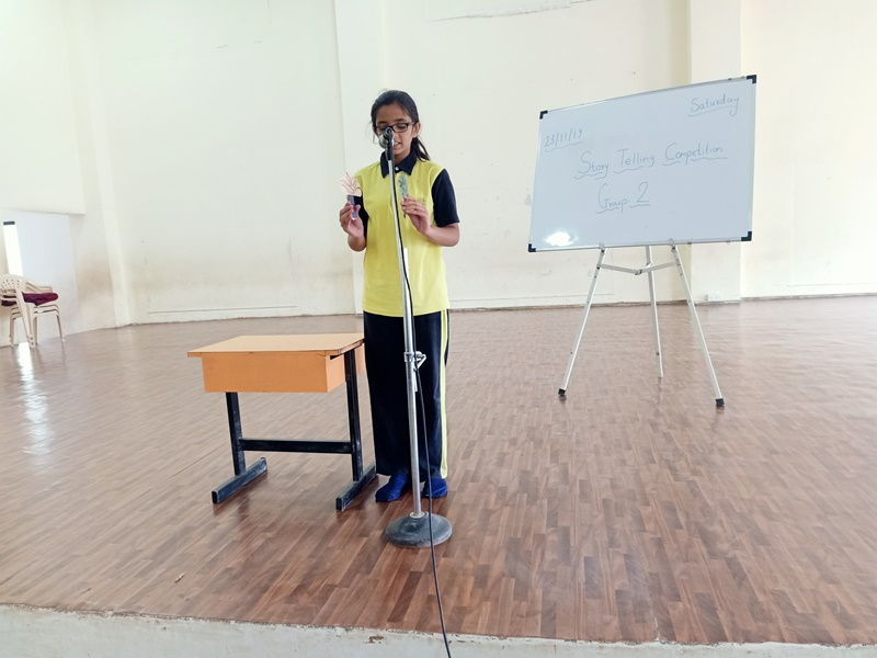Miss. Eshal Patil presenting story with pupets