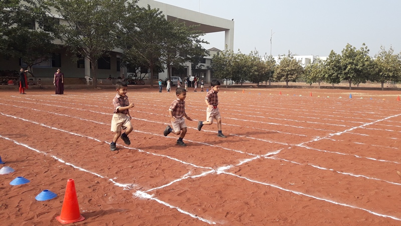 Pre-Primary students preforming in running race