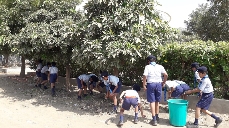 Students collecting singal use plastic in school campus