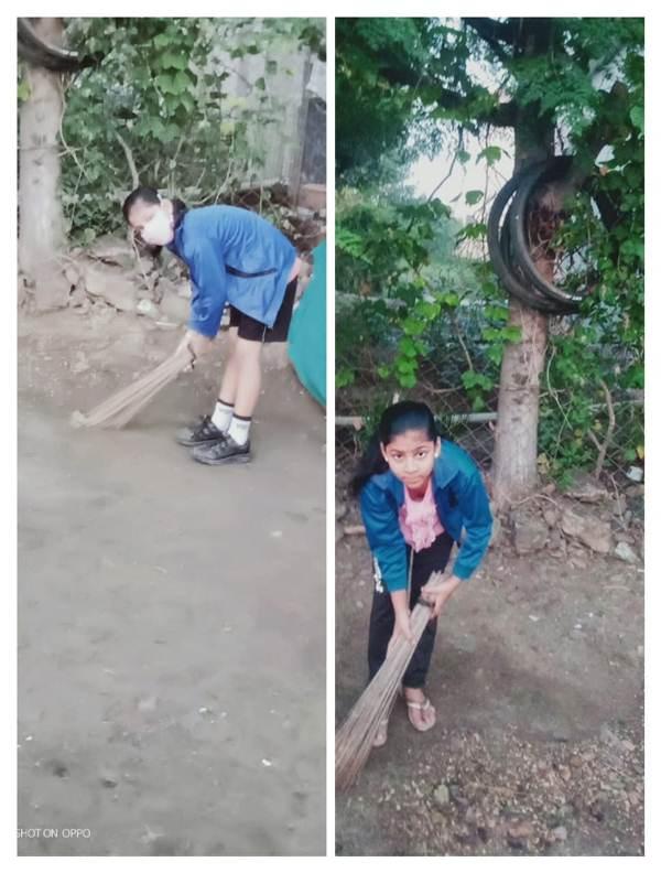 Anjali Khamgal std-6 B Anjali Khamgal cleaning the surrounding
