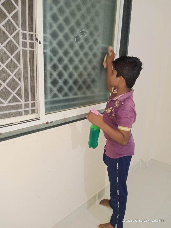 Krishna Garde from 4th B. Wiping window panes with wet cloth